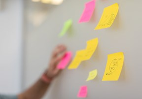 sticky notes on a white board