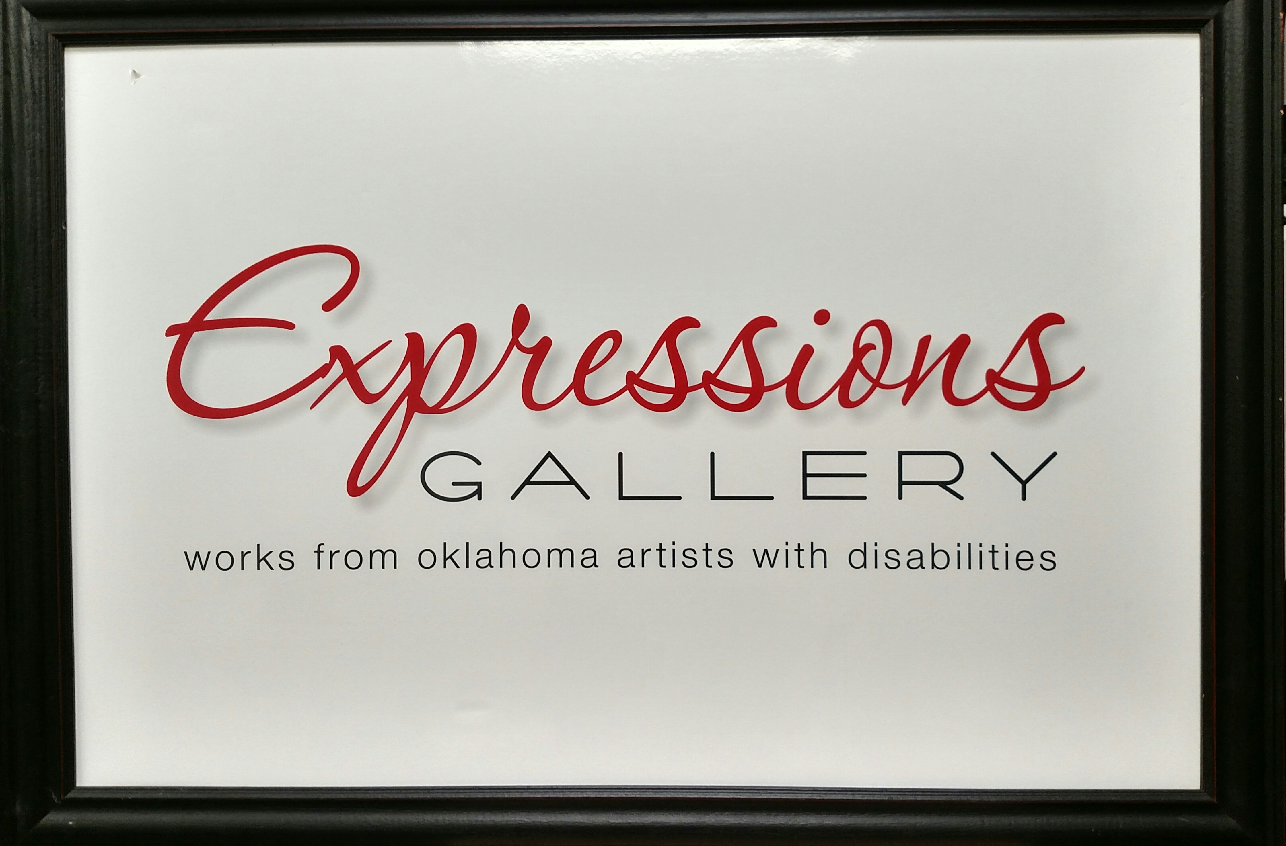 "picture frame with ""expressions gallery works from oklahoma artists with disabilities"" in the middle"